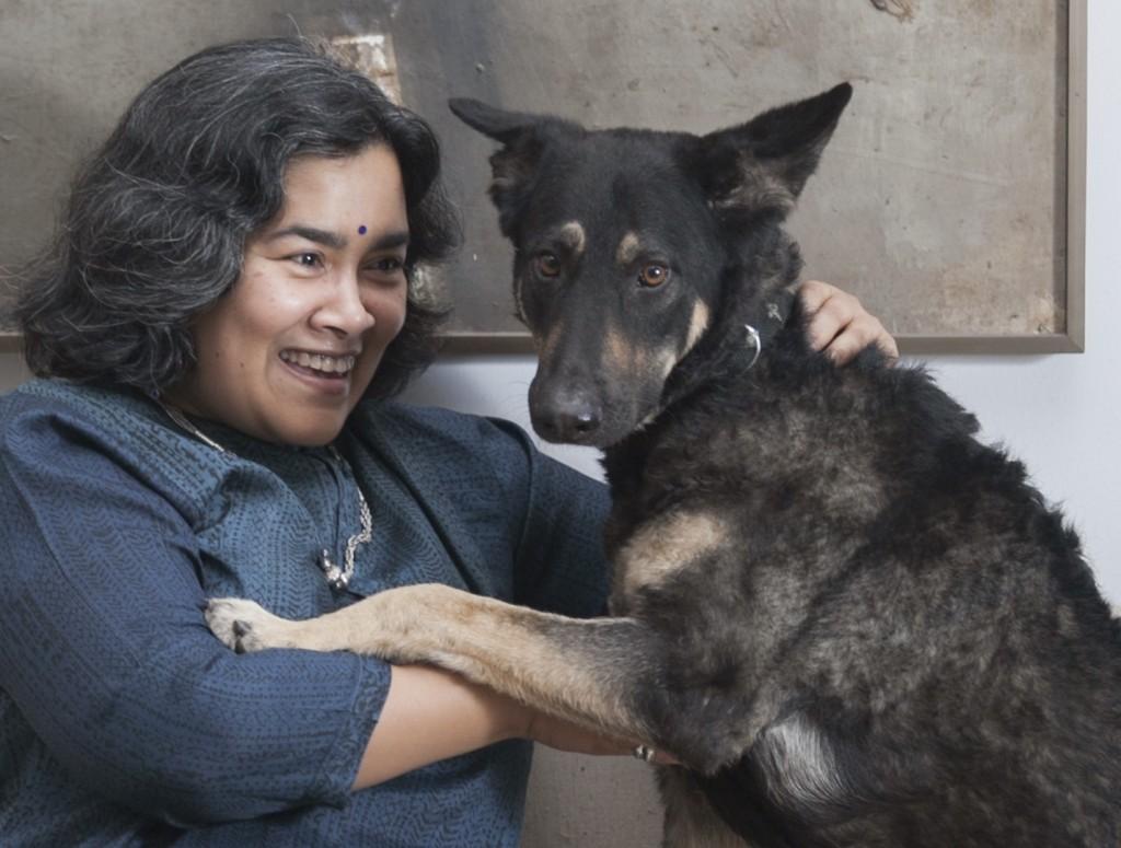 Farah with Mila, her German shepherd. Photo: Prito Reza, Ice Today