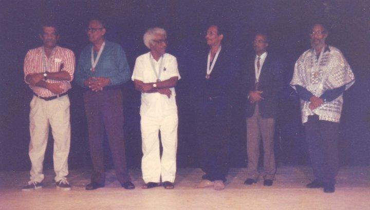 Left to right: Derek Walcott, Martin Carter, George Lamming, Earl Lovelace, Ernest Moutoussamy and Kamau Brathwaite. at Carifesta in Trinidad, 1995
